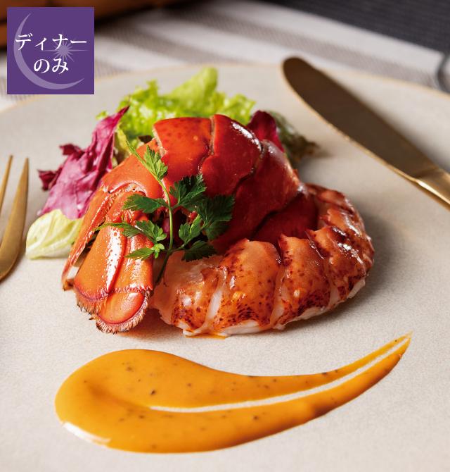 オマール海老のポアレ トリュフ風味のアメリケーヌソースの写真